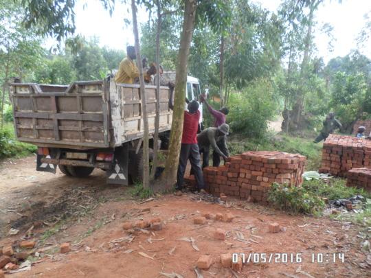 Loading bricks on Idjwi