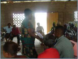 Lydia Sasu and rural farmers discuss food security
