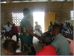 Lydia Sasu and rural farmers discuss food security