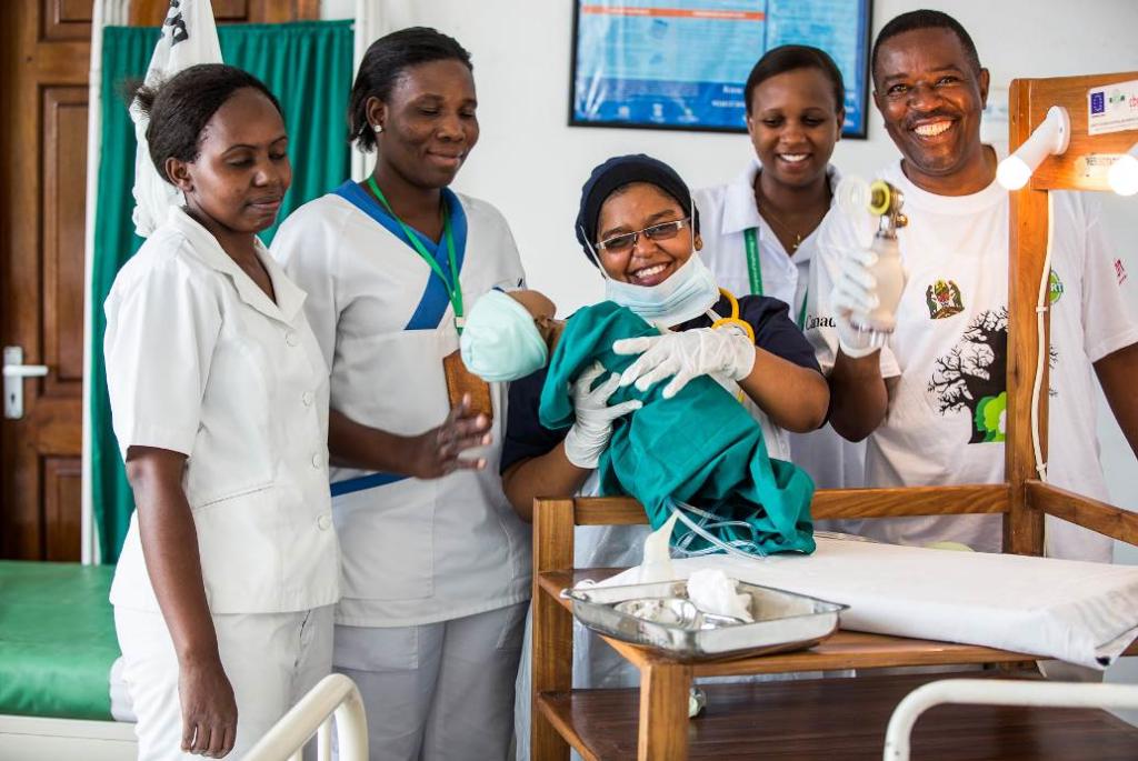 Nurse Intisar (center). Photo by Sala Lewis