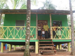 Nicaraguan Family in front of New Bamboo Home