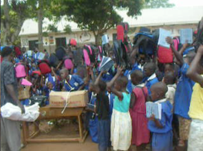 Children show their excitement to receiving packs