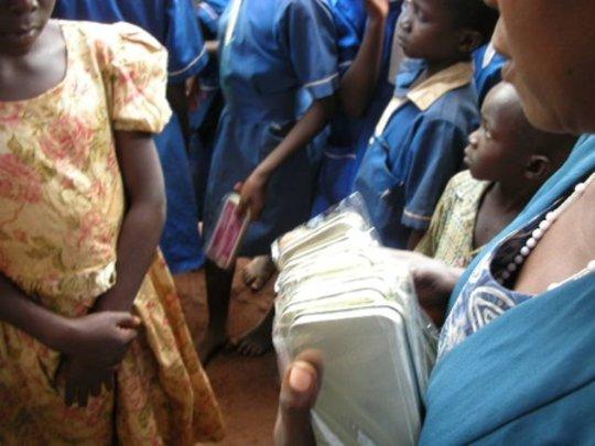 Children receiving school supplies