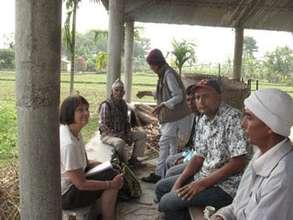 Carol and partners at Chisang Clinic meeting