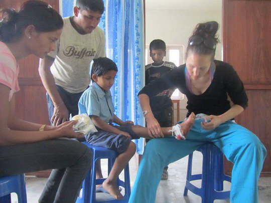 Volunteer Dr. Cranmer tends to young patient