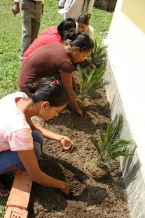 Staff and volunteers each dedicate a plant.