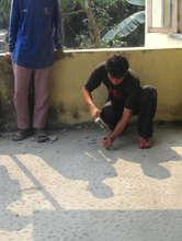 Masonworker putting finishing touches on floor