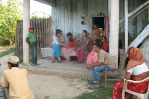 House visit attracts other villagers.