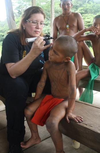 Dr Stella Rowley examining a little boy