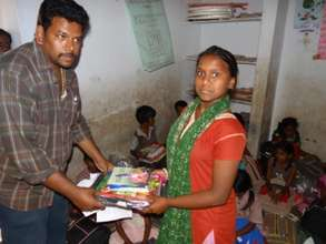 Providing bag and books for a girl child