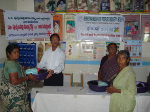 Dr.P.S.Reddy distributing medical kits to patients