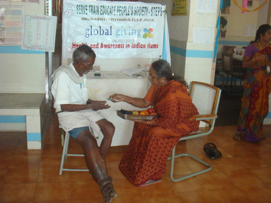 Explaining about medicines to Filariasis patient
