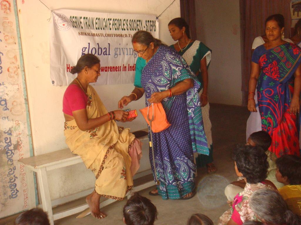 Vajramma LF patient with medicines in health camp
