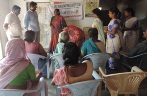 Mr.Veera Reddy with slum people during field visit