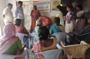 Mr.Veera Reddy with slum people during field visit