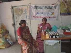 Dr Prameelamma explaining about medicines