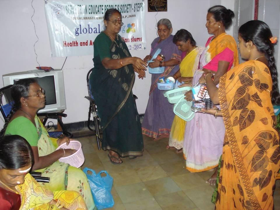 Dr.Prameelamma distributing drugs to LF patients