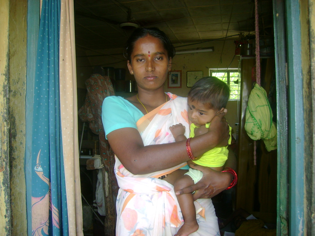 Mrs.Munilakshmi with her Child