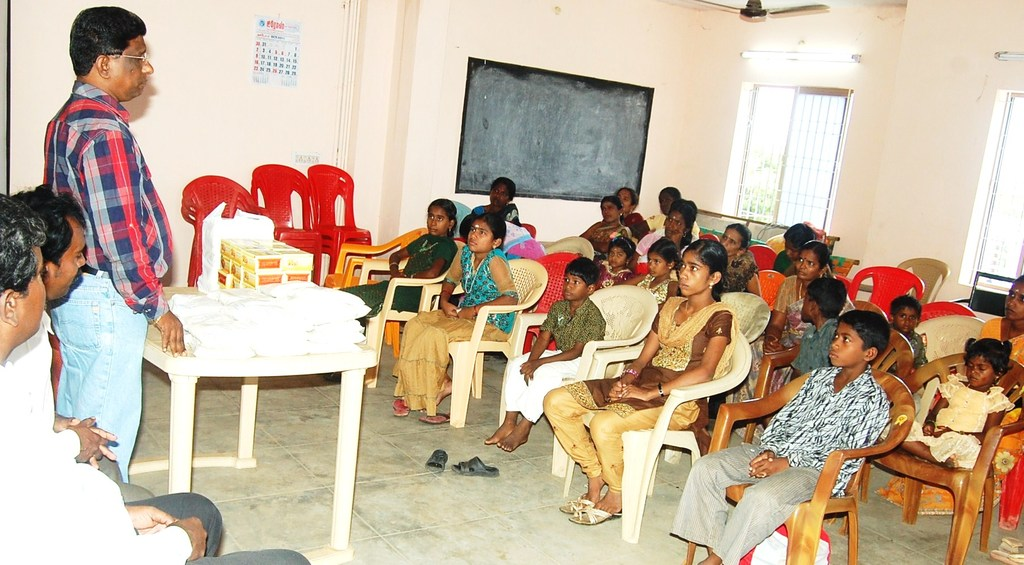 Children watch as CRS Director speaks