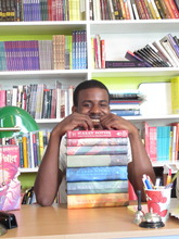 Gerald with his favorite books: Harry Potter!