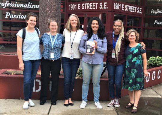 Author Elizabeth Acevedo (center) visits DC Jail