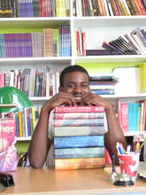 Gerald shows off his books
