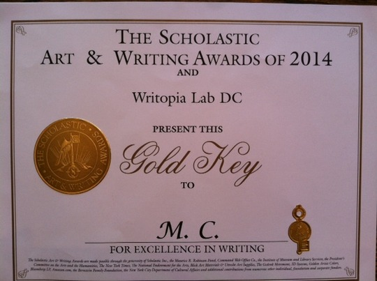 "Muquan's ""Gold Key"" certificate from Scholastic"
