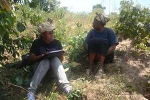 Triza Visiting A Farmer, Collecting Baseline Data