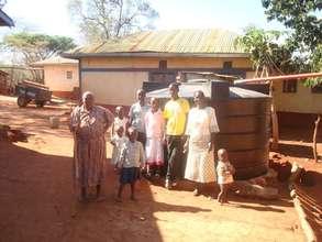 Mukita Nyolo and family with new rainwater cistern