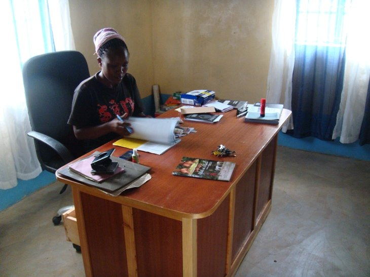 Office Manager Theresa Mbinya doing bookkeeping
