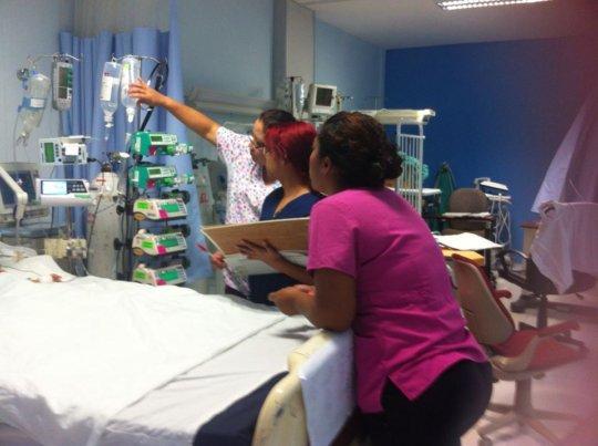 Nurse Ana Rosa tends to child
