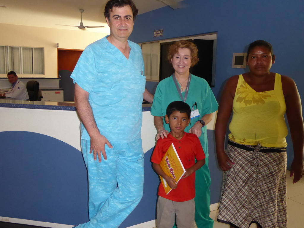Andro with the team cardiologist and his mother