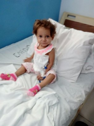 Artenis, 16 months, is ready for her surgery.