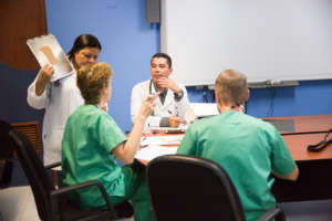 Dr. Katrien (2nd from left) discussing surgery.