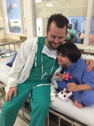 Dr. McKenna reassures Brayan before surgery
