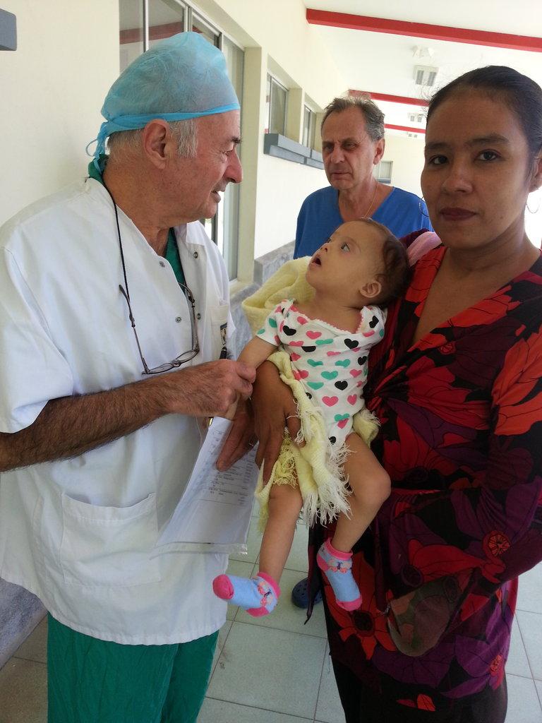 Dr. Metras Greets Baby Lesyenia Before Surgery