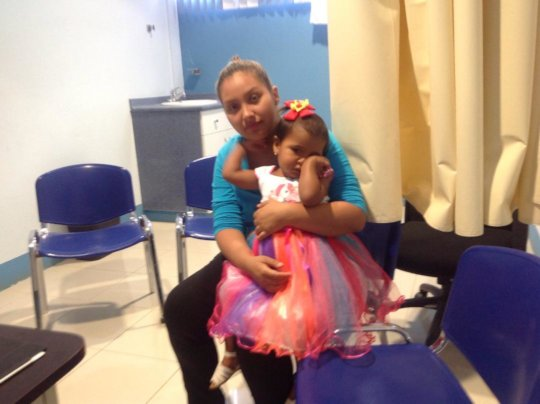 Adriana (2), from Managua, with her mother.