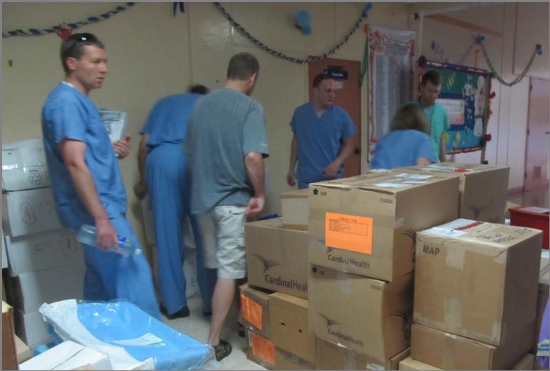 Team Prepares to Unpack Surgical Supplies