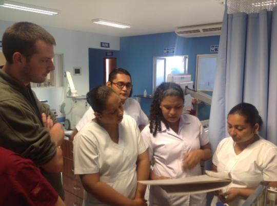 Team confers about patient
