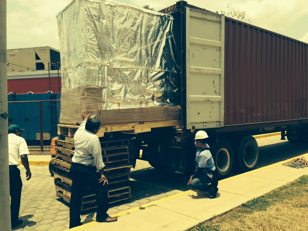 The first bulky package is unloaded