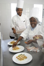 Students plating food for a luncheon
