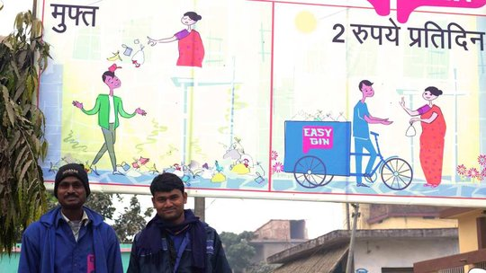 Lalbabu and Naveen pose under an EasyBin banner
