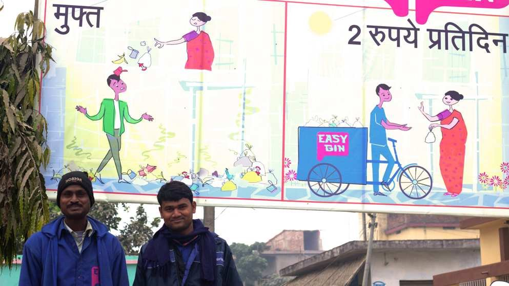 Lalbabu and Naveen pose under an EasyBin banner
