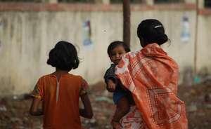 Waste picker mother and children
