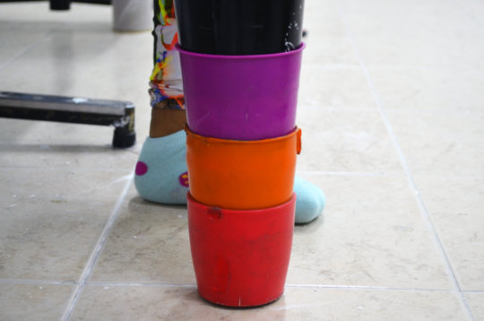 A prosthesis crafted with colorful plastic cups.