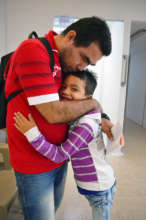 Matias hugs his father.