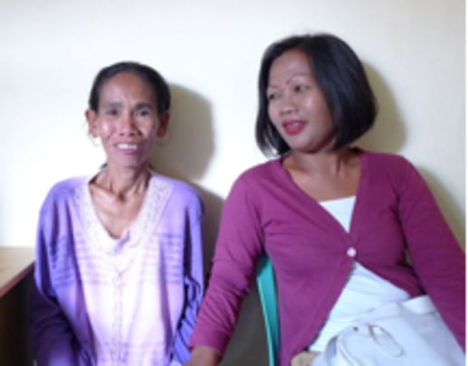 Ibu Hamisah and one of her patients