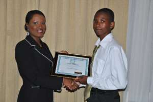 CEO Nikiki Bogle awards Ravorn a Scholarship 2010