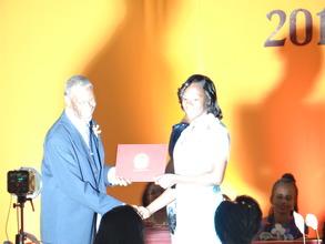 Coya receives High School Diploma