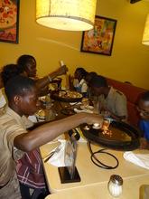 CEF Scholars having pizza in New Kingston
